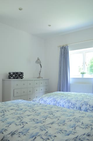 Rear bedroom with twin