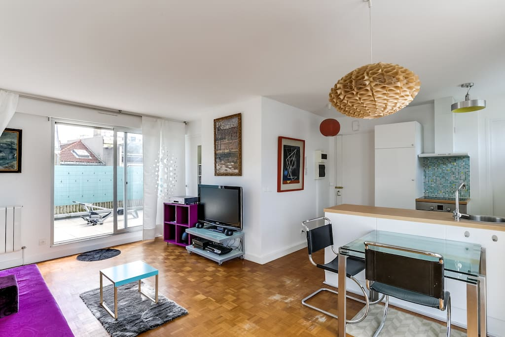 The 30 square meters living room has 2 glass doors leading to the terrace . It is equipped with : dining table for 4 people, single sofa bed, cable, TV, DVD, stereo, hard wood floor.