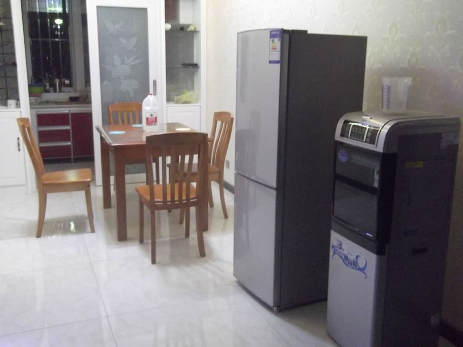 new dinning chair and table,new fridge and water cooler at the small sitting room.