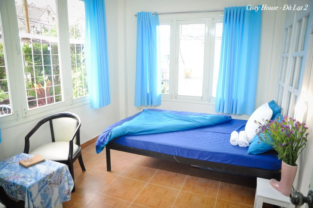This is a bedroom with many windows and light