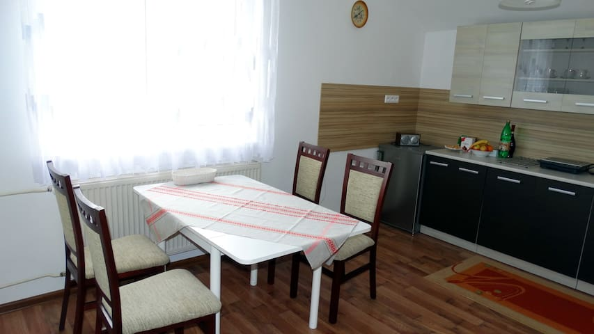 Dining table can comfortably seat 4 people, we can provide additional 2 chairs when needed.
