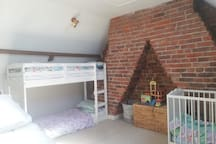 Bedroom 2, loft Room. Option of king day bed (sleeps 2 adults), bunk beds (sleeps to children/ teenagers), and cot. Or all of them!