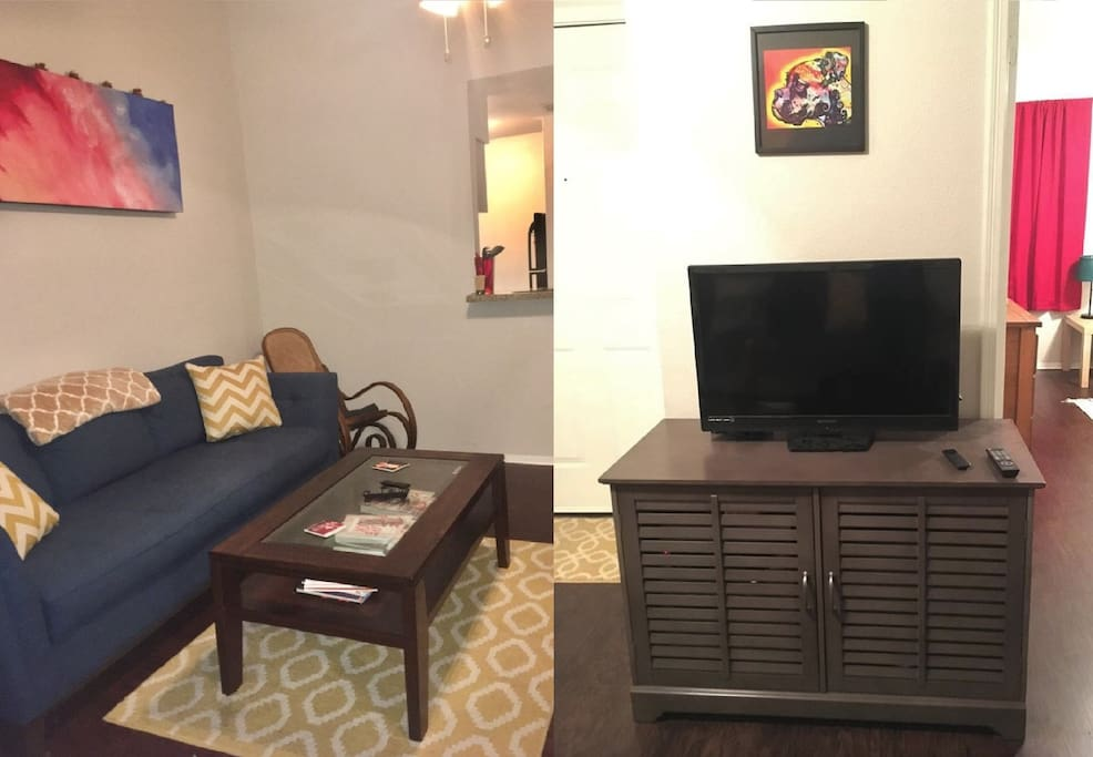 Living room includes extra large couch and TV with antenna