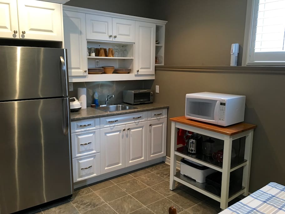 Kitchenette with small appliances, dishes, utensils, refrigerator, etc