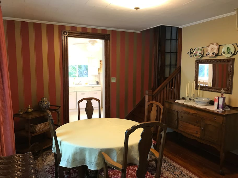 Dinner, card games, lively conversation and good times await you in the dining room, staircase to the second floor bedrooms as well.