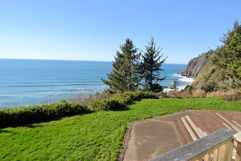 Balcony off of upstairs bedroom with amazing ocean views. (Please be aware this is a cliffside location~steep drop and no fencing)