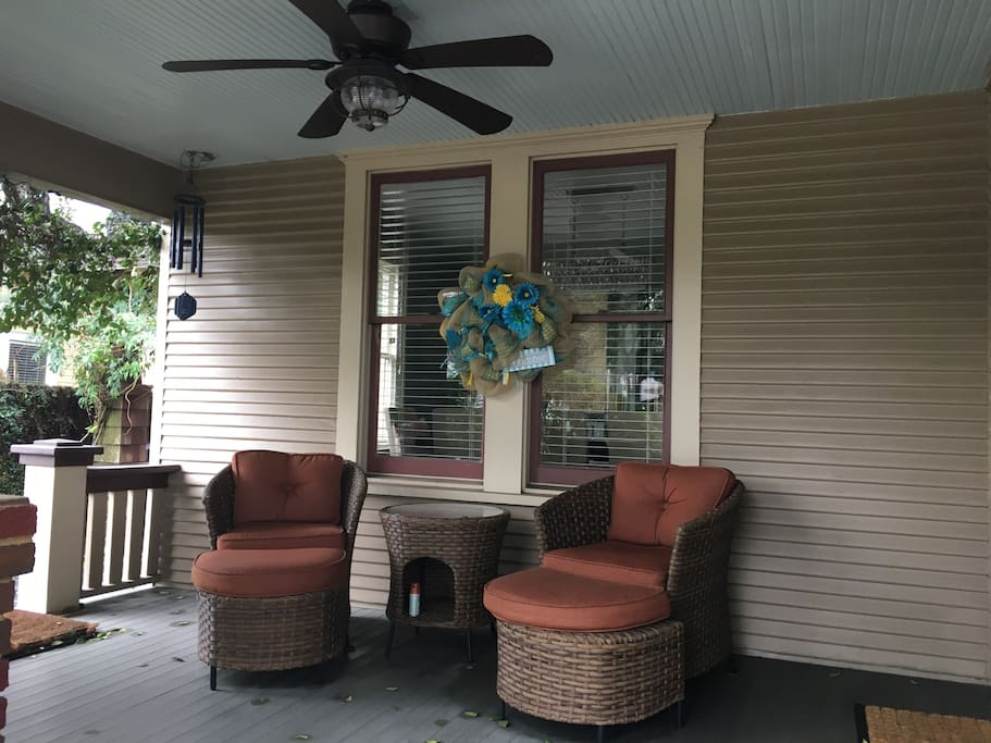 Cozy front porch great for enjoying a glass of wine