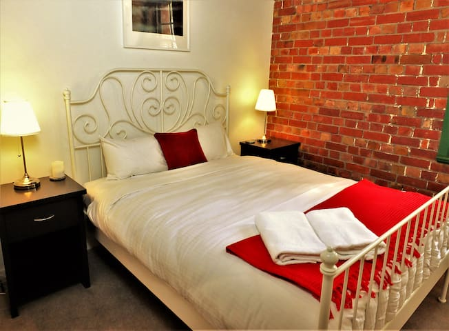 Rest easy and breathe in the old world charm and relax on the beautiful white queen bed