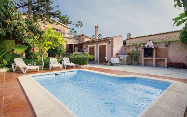Gran casa mallorquina con piscina y jardín privado