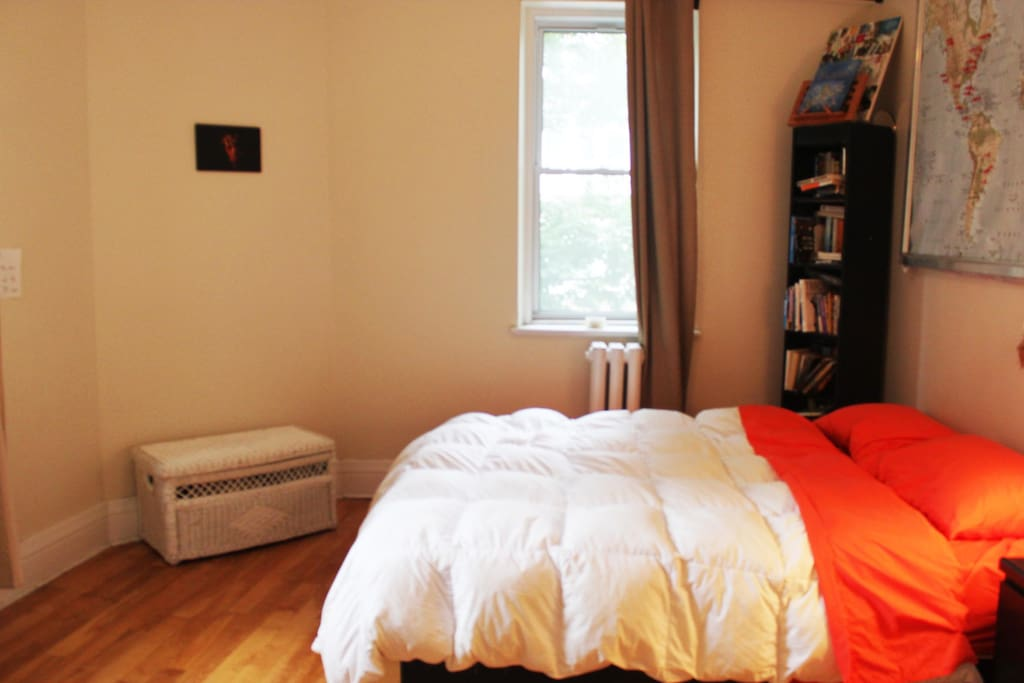 Queen-sized bedroom with two bright windows overlooking Mount-Royal.