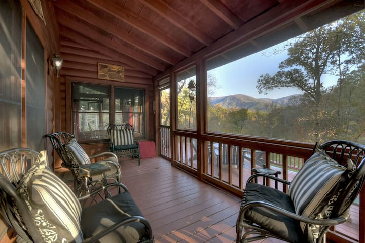Mountain Vista is tucked away in the woods, with a lovely view, hot tub and fire-pit