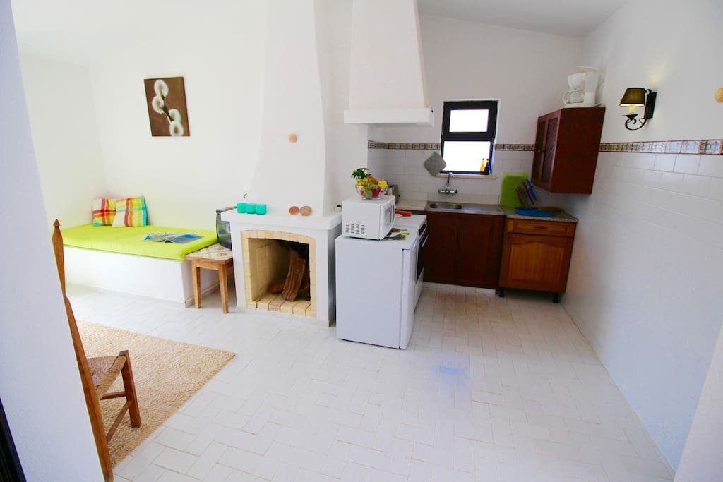 Fully equipped kitchen & fireplace