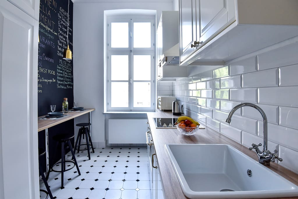 Kitchen with big double wooden window.