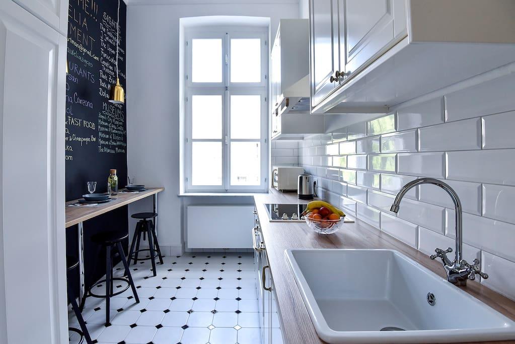 Kitchen with big wooden window