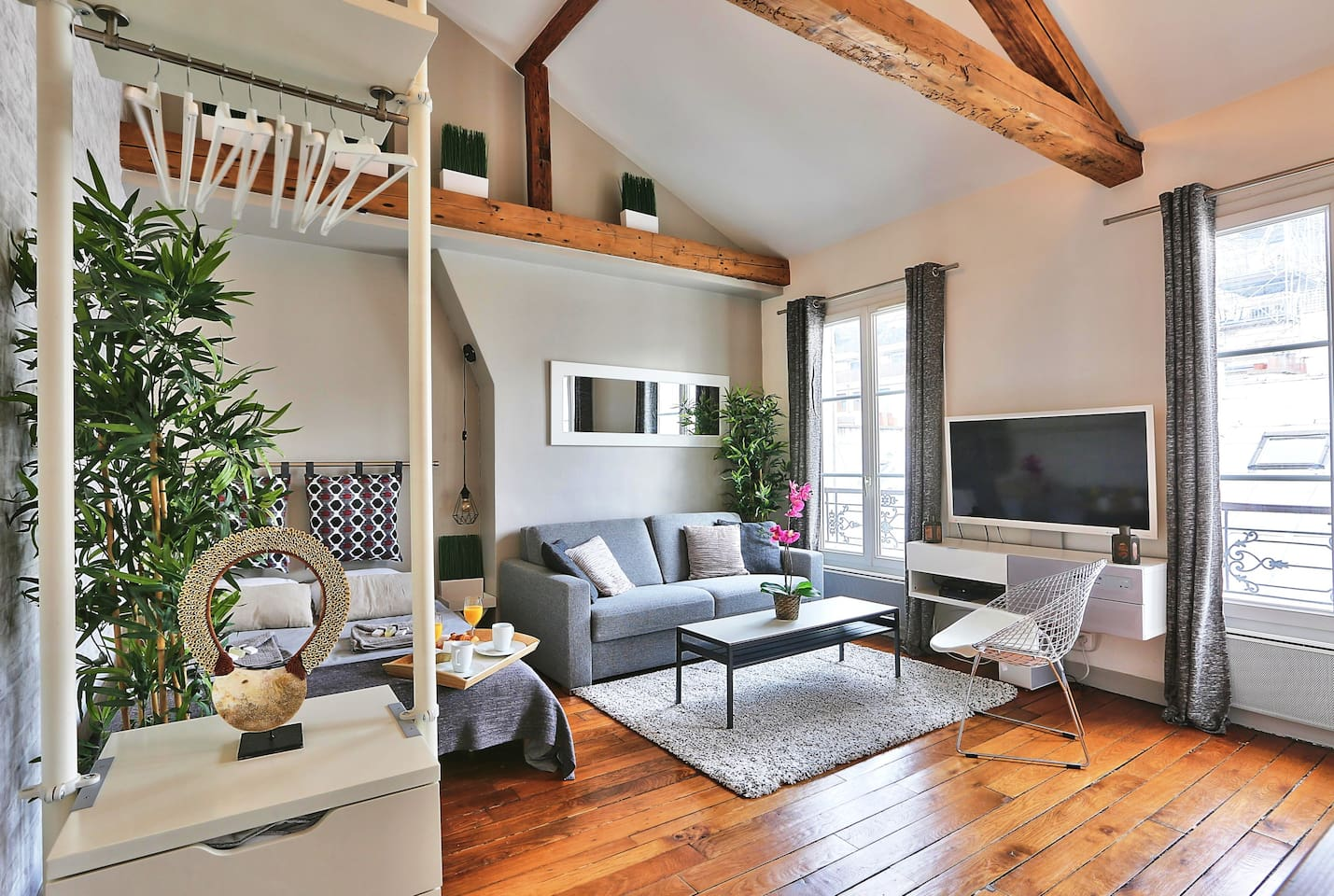 Exposed beams and a beautiful wooden floor.