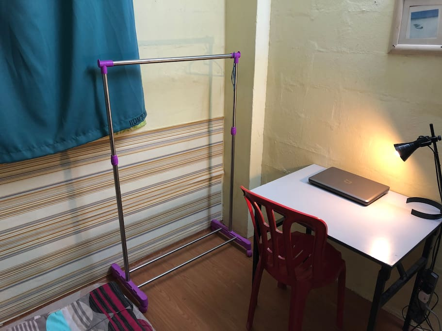 Working table and cloth hanger