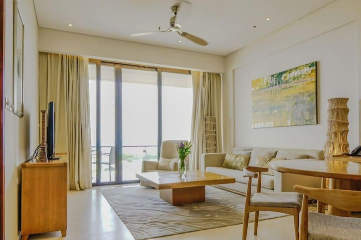 Full sofa, desk, cable TV, DVD player with full curtains to beautiful balcony.