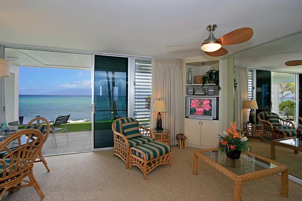 This lovely living room is great for lounging and has a wonderful ocean view.