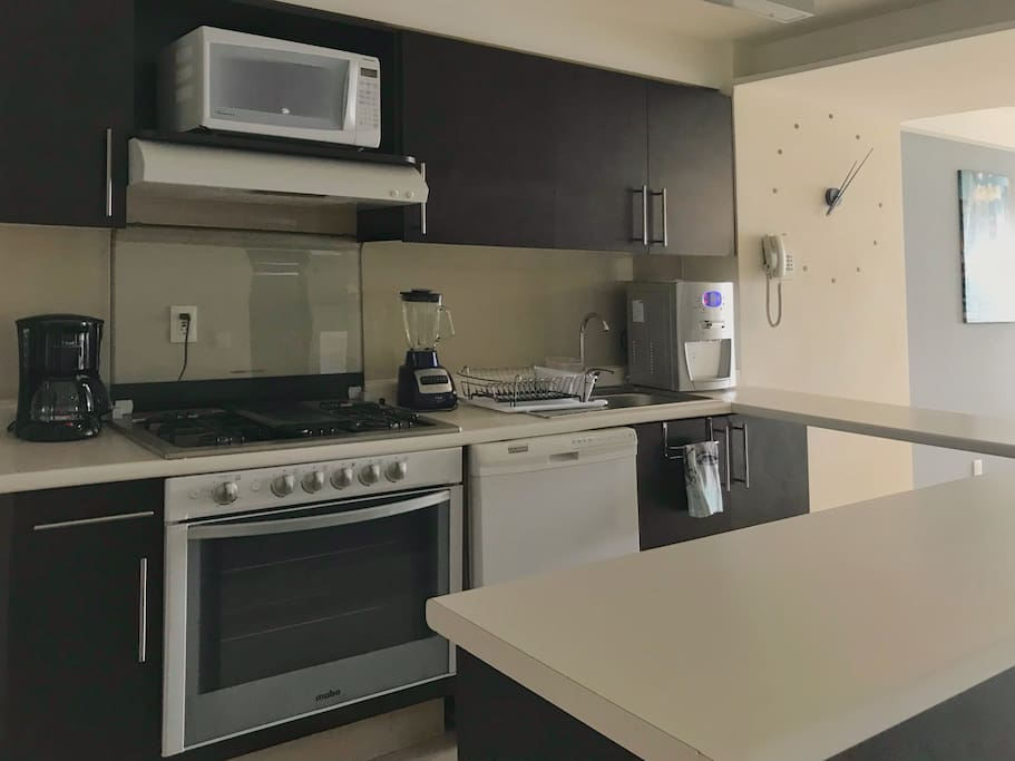 Kitchen full equipped (Microwave, oven, refrigerator, dish washer, blender, coffee machine, hot/cold water filter & Toaster)