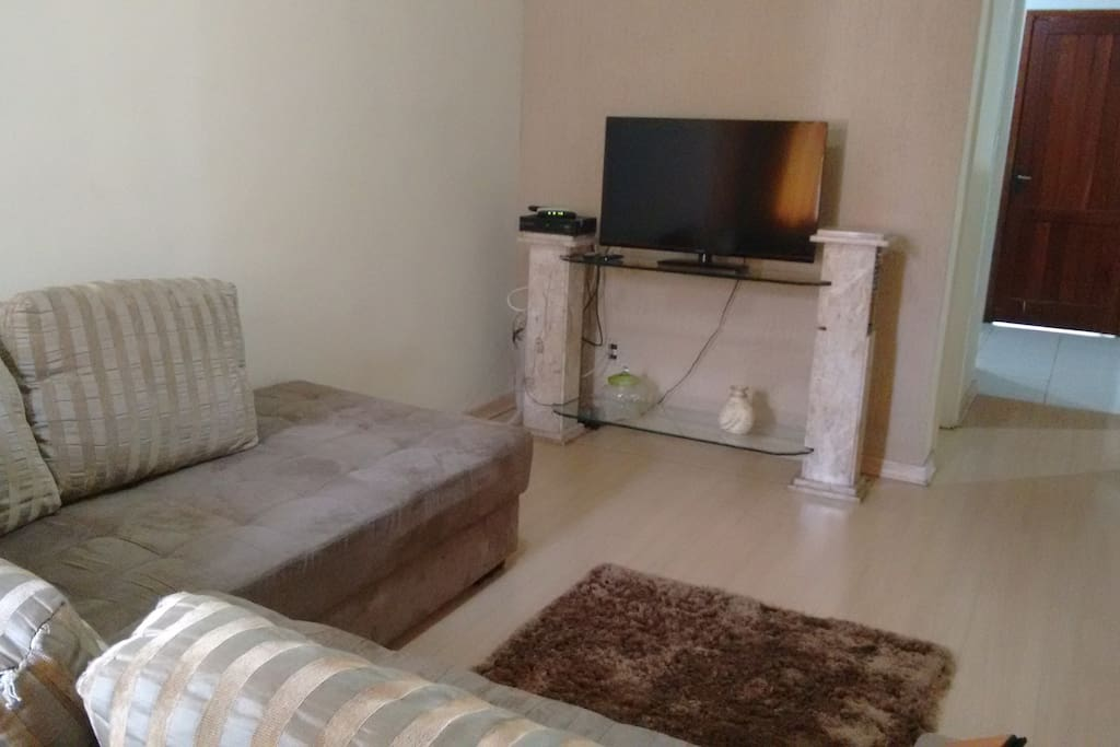 Tv com acesso a TV a cabo NET controles disponíveis