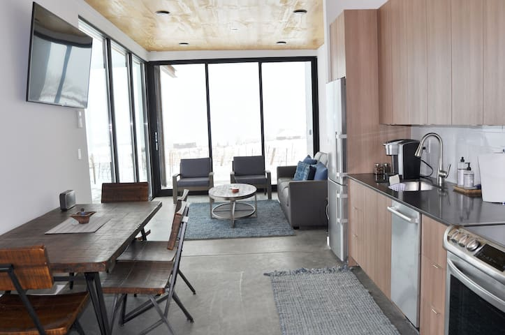 View of dining, kitchen, and living area