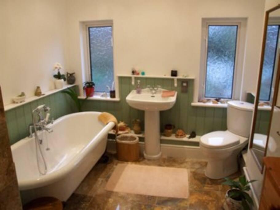 Modern Bathroom with shower, roll top bath and under floor heating.