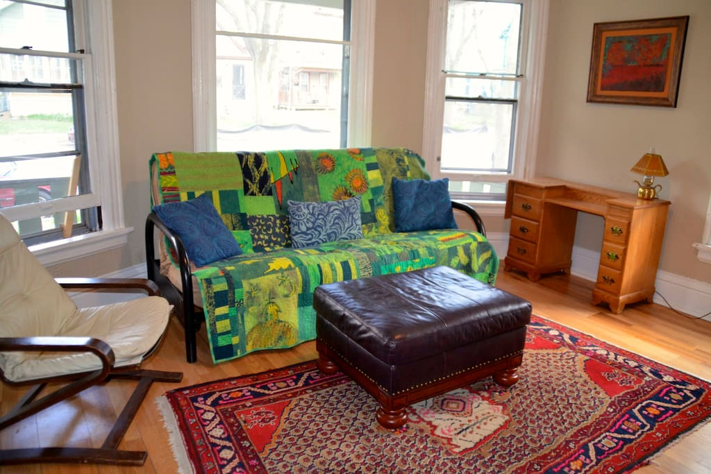 The futon sofa folds into a second queen bed when needed.  The quilt is made by me!
