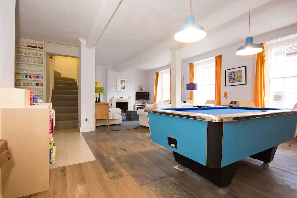 The sitting room - open plan through to the kitchen on the left. The pool table converts to a very large dining table which can also be used for table tennis