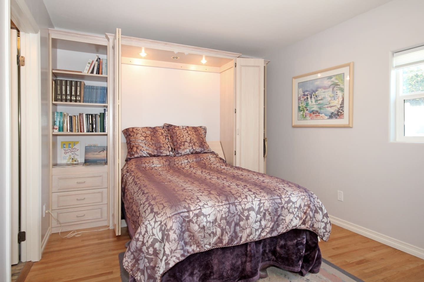 Comfortable, full-sized Murphy Bed in a quiet, private area of house
