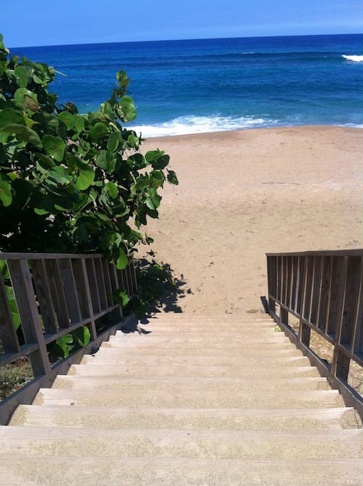 Stairs that lead to the beach at the end of the road