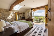 Luxurious master bedroom in The Cow Shed