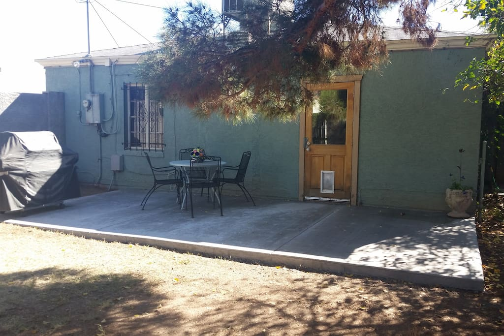 Back patio. Has a gas BBQ grill, table, chairs, lovely evening lights and plenty of shade. All, surrounded by 6' block wall. Very private and pet secure.