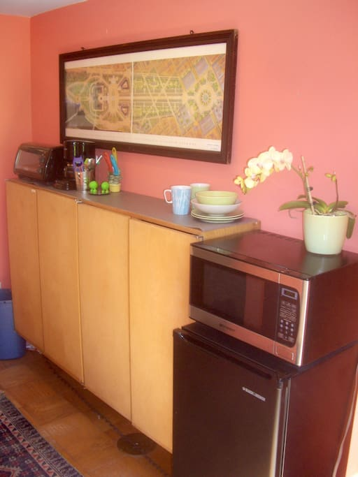 Kitchenette with the microwave, refrigerator, induction cook top, toaster-oven, electric kettle,  and coffee-maker.