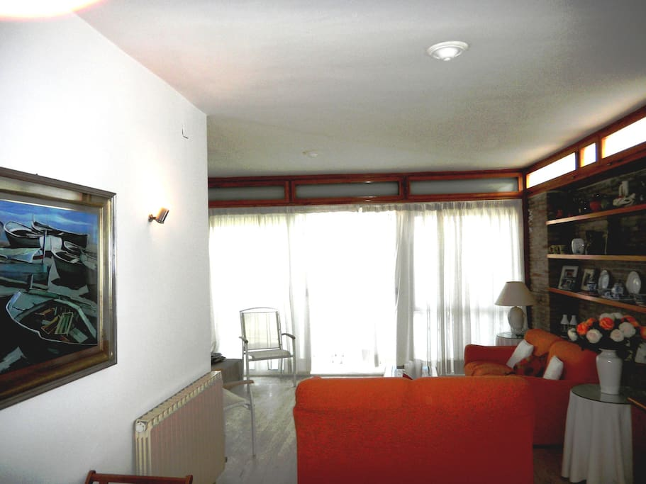 A view of the living room leading to the terrace