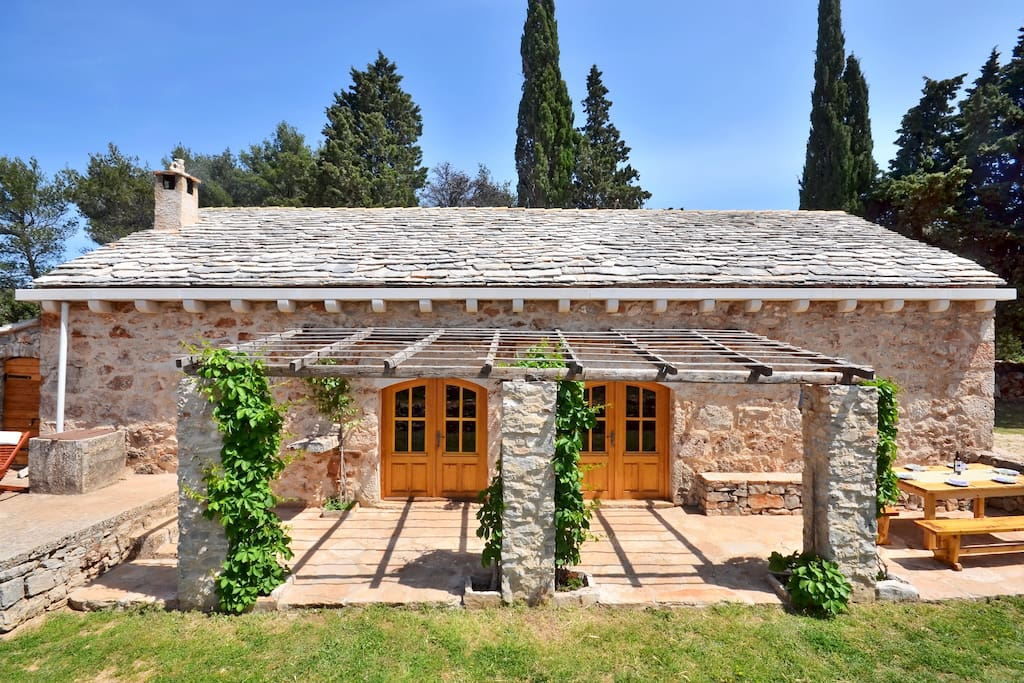 Stone house with big table in front, you will have complete privacy