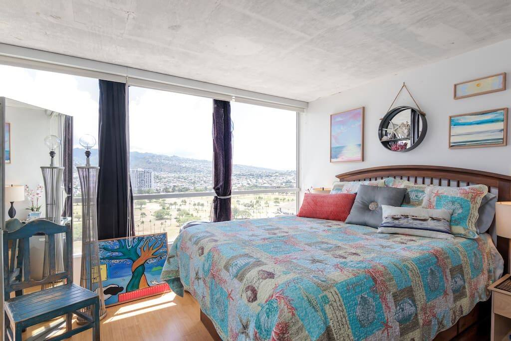Queen Bed in room with views