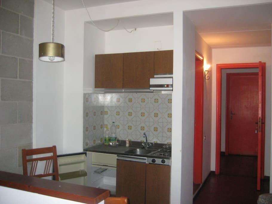 The kitchen area of the studio apartment