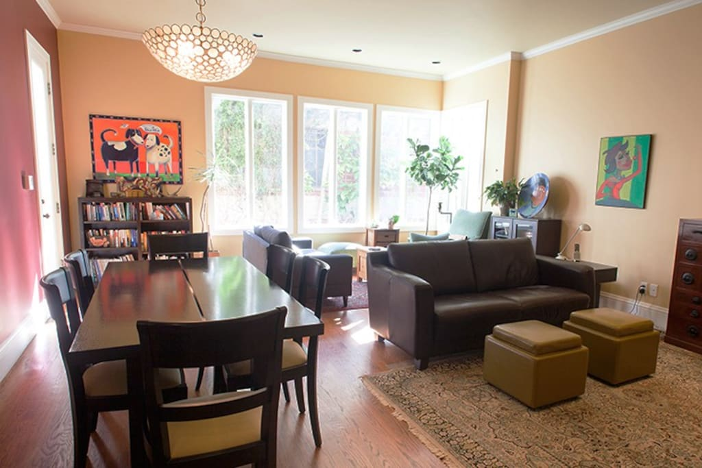Open-plan dining and living areas. Reading and sitting area near back windows and separate tv/entertainment area