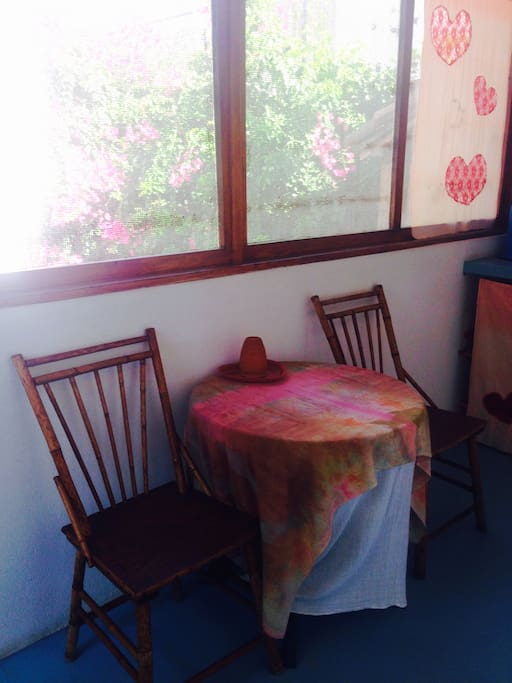 Table with two chairs in the terrace, views to garden. Mesita con dos sillas en la terraza. vista al garden.
