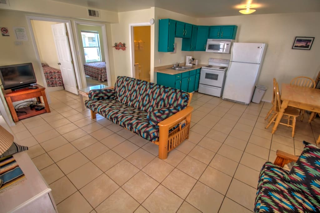 Full Kitchen with Fridge, Stove,  & Microwave.