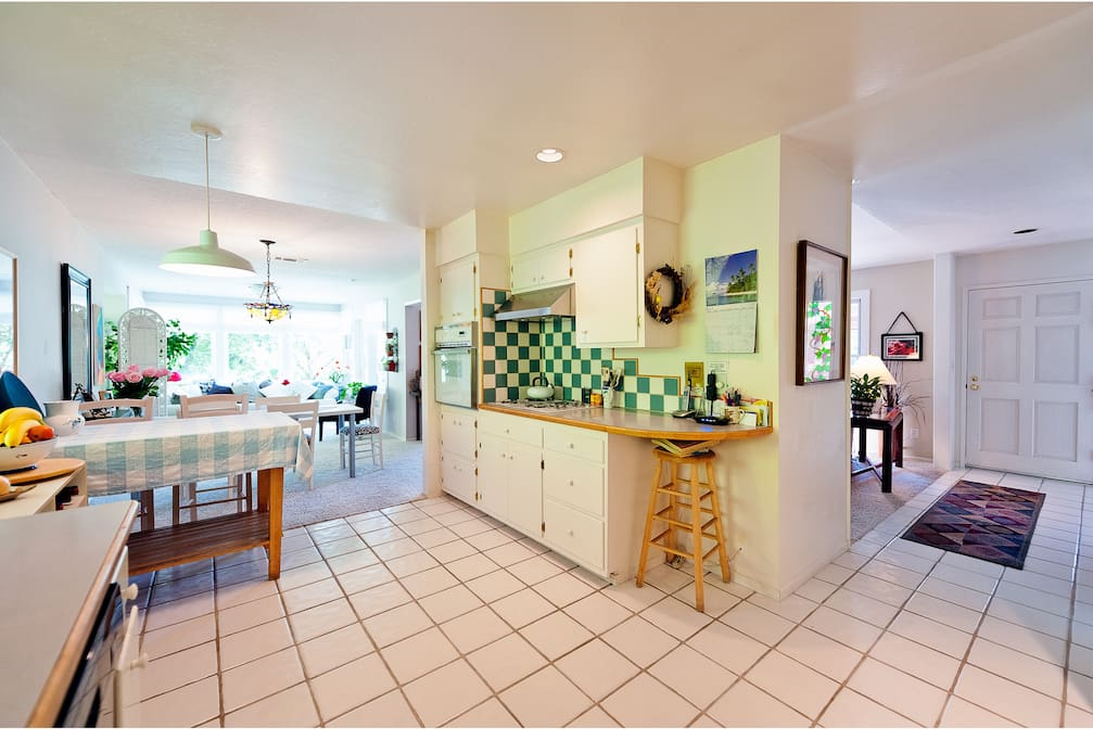 Kitchen with view to front hall and front door