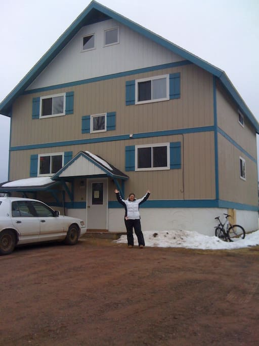Cindy, the day she bought the chalet.  I got the rock in the back yard.