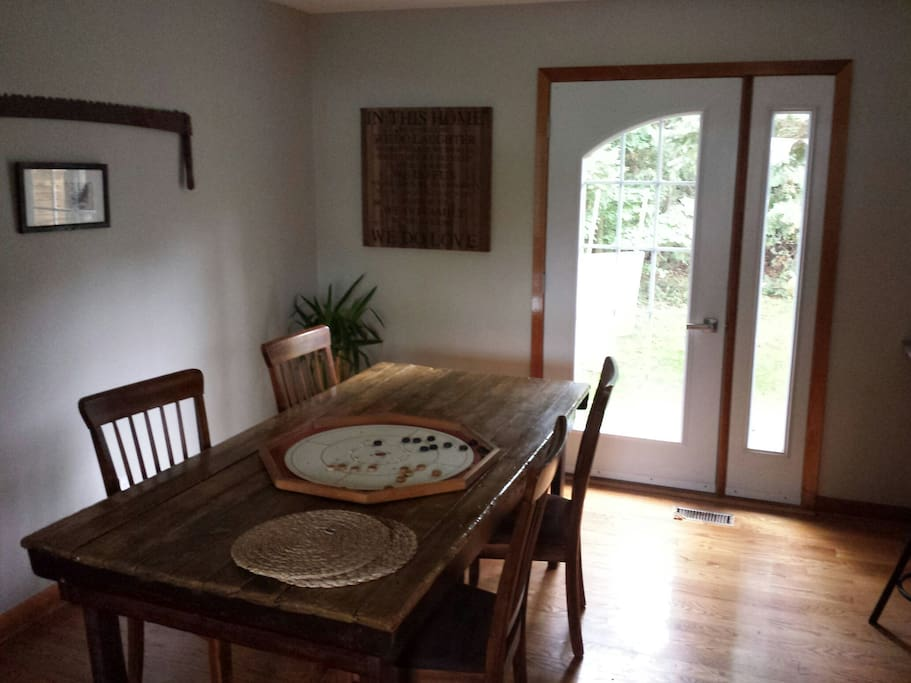 Kitchen/ding room with door out to back deck