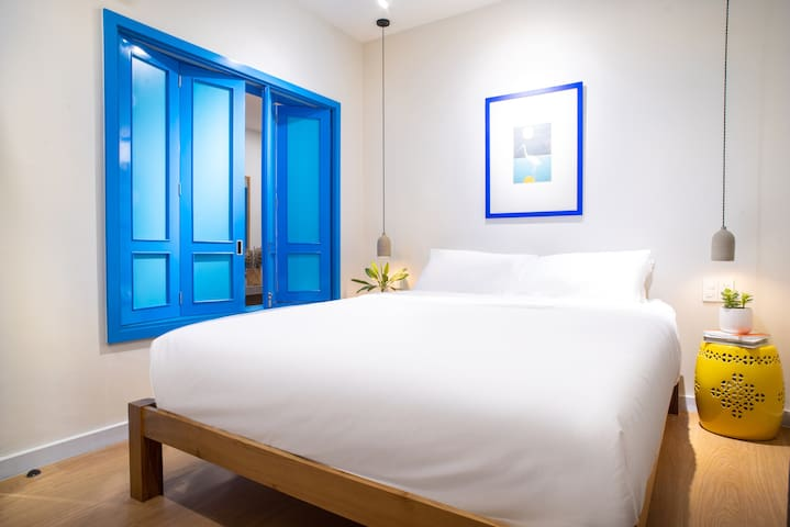 A peek into our first bedroom. We have a thing for blue windows