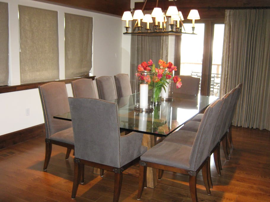 Entertain family and friends at the large dining table surrounded by large windows.