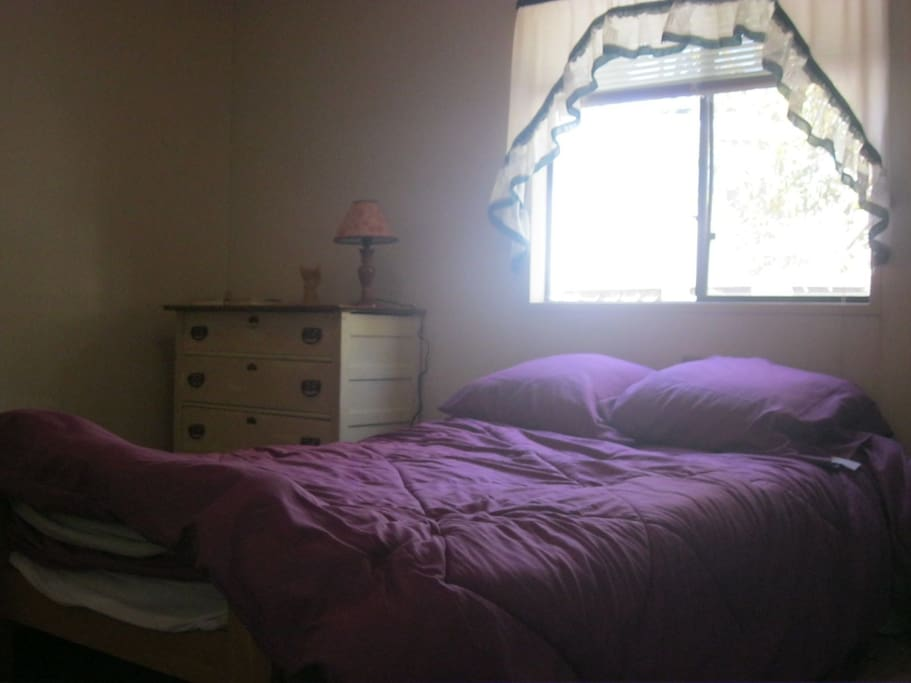 Bedroom: Double with book shelf, closet, dresser and lamp....with private bath across the hall
