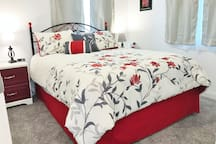 The Red Floral bedroom on the first floor features modern red highlights!