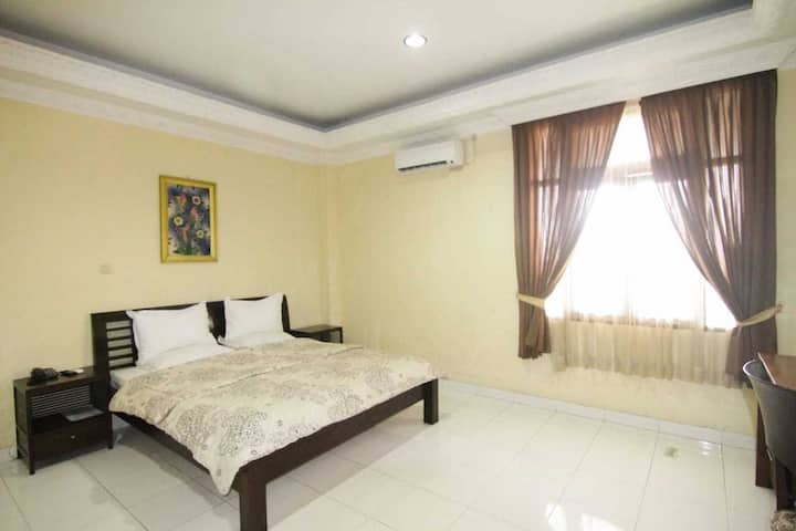 Clean Suite Double Bed at Grand Situ Buleud Hotel