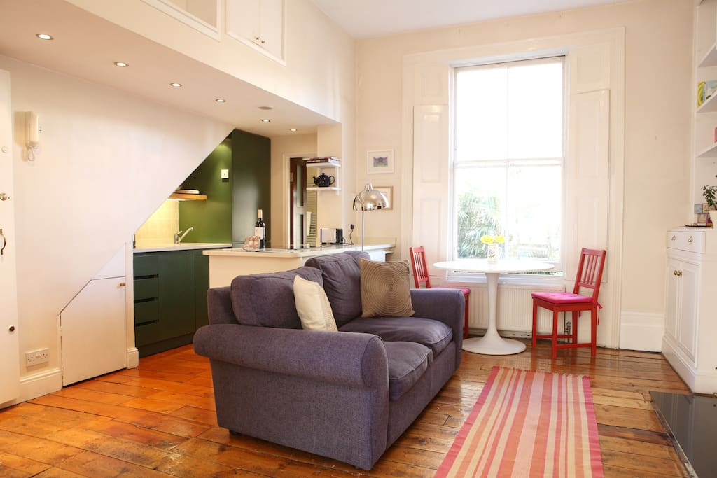 Lounge area with huge sash windows and high ceilings