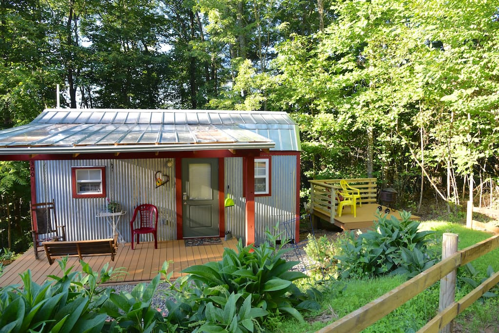The deck to the right of the tiny house is ready for you to enjoy an evening campfire. We provide the fire wood and kindling.